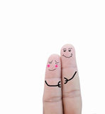 Couple in love painted on fingers.  Stock Photography