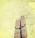 Couple in love painted on fingers.  Royalty Free Stock Images