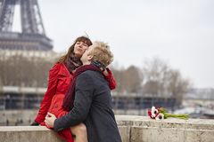 Couple in love in Paris, near the Eiffel tower Stock Photo