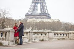 Couple in love in Paris, near the Eiffel tower Royalty Free Stock Image