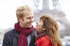 Couple in love in Paris, near the Eiffel tower Royalty Free Stock Photos