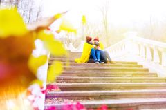 Couple in love in park in autumn Stock Photo