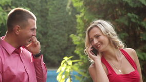 Couple in love in the park with phone stock footage