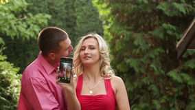 Couple in love in the park with phone stock video