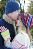 Couple in love in the park in winter Stock Photos