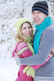 Couple in love in the park in winter Royalty Free Stock Images