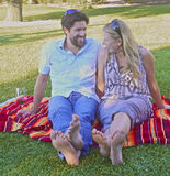 Couple in love picnicking in the park