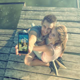 Couple in love on the pier, selfie photos Royalty Free Stock Photo