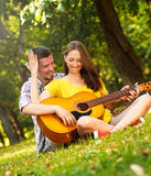Couple in love playing acoustic guitar Stock Photo