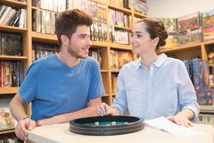 Couple in love playing ludo board game at store Royalty Free Stock Image
