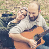 Couple in love playing serenade with guitar Royalty Free Stock Photo