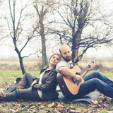 Couple in love playing serenade with guitar Stock Image