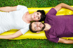 Couple in love. Portrait of happy couple lay on the grass Royalty Free Stock Photography