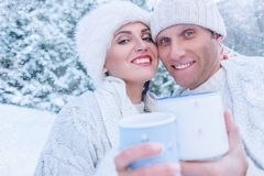 Couple in love portrait in snow forest Royalty Free Stock Photos