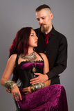 Couple in love posing at studio dressed in classic clothe Royalty Free Stock Image