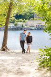 Couple in love posing under tree at riverbank at sunny day Stock Images