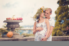 A couple in love during pregnancy in the park Royalty Free Stock Image