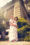 A couple in love during pregnancy in the park Stock Photo
