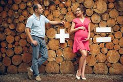 Couple in love pregnant cuddling, waiting for baby on wooden background stock photo