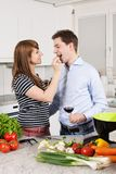Couple in love preparing a meal Stock Photo
