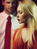 Couple in love of blonde woman in red and man stock images