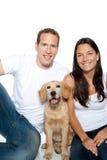 Couple in love puppy dog golden retriever Stock Photo