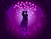 Couple in love on purple background among the many hearts. Stock Photography