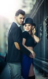 Couple in love in railway station. Beautiful well-dressed couple standing on railway platform Royalty Free Stock Photos