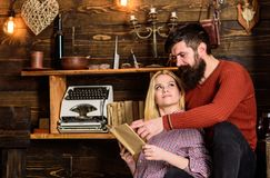 Couple in love reading poetry in warm atmosphere. Romantic evening concept. Lady and man with beard on dreamy faces with. Couple in love reading poetry in warm royalty free stock photography