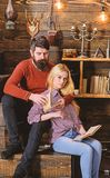 Couple in love reading poetry in warm atmosphere. Romantic evening concept. Lady and man with beard on dreamy faces hugs. Couple in love reading poetry in warm royalty free stock photo