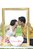 Couple in love with rectangle frame Stock Image