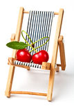 Couple in love.red cherryes on the beach chair Stock Photography