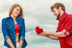 Couple in love with red heart outdoor Royalty Free Stock Image