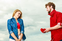 Couple in love with red heart outdoor Stock Image