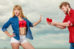 Couple in love with red heart outdoor Royalty Free Stock Images