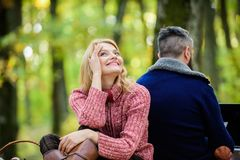 Couple in love relax in autumn forest with laptop. Family picnic. Relationship. camping and hiking. happy girl dreaming. Men sit with back. Spring mood royalty free stock image