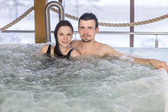 Couple in love relax in a bath stock images