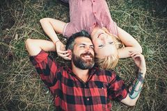 Couple in love relax on green grass. Couple in love enjoy summer day on nature. Couple in love relax on green grass. Couple in love enjoy summer day on nature royalty free stock image