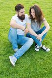 Couple in love relaxing on green lawn. Lovely couple outdoors. Simple happiness. Couple relations goals. Couple spend. Time in nature. Playful girlfriend and royalty free stock photography