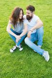 Couple in love relaxing on green lawn. Lovely couple outdoors. Soulmates closest people. Simple happiness. Couple. Relations goals. Couple spend time in nature stock image