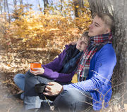 Couple in love resting in autumn park Stock Photos