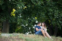 Couple in love resting under the trees Royalty Free Stock Photos