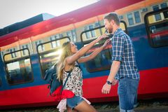Couple parting for some time. Couple in love reunion after traveler arrives royalty free stock image