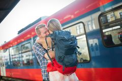 Couple parting for some time. Couple in love reunion after traveler arrives royalty free stock images