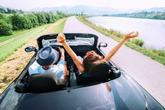Couple in love ride in cabriolet car Stock Photography