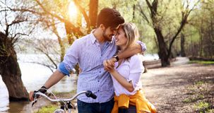 Couple in love riding bicycle in city and dating. Beautiful couple in love riding bicycle in city and dating Royalty Free Stock Photos