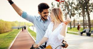 Couple in love riding bicycle in city and dating. Beautiful couple in love riding bicycle in city and dating Stock Photography