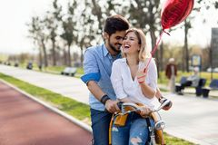 Couple in love riding bicycle in city and dating. Beautiful couple in love riding bicycle in city and dating royalty free stock image