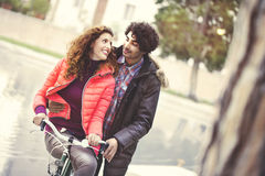 Couple in love riding a bicycle together Royalty Free Stock Photo