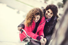 Couple in love riding a bicycle together Royalty Free Stock Images